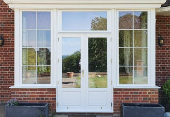 French Doors with Period panels finished with Polished Brass hinges