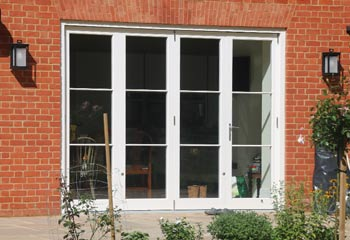 Bifold Doors can look very traditional with addition of narrow but detailed astragal bars