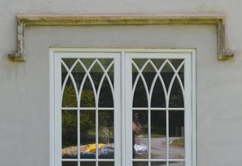 Recessed Cothic casement windows of unusal proportion