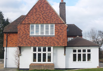 Replacement and new timber Flush casement windows and doors with Leaded lights for cottage in Tadworth, Surrey