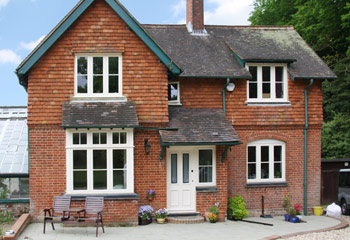 Replacement timber Flush Casement windows in Cottage Style for this rustic cottage in Dorking, Surrey