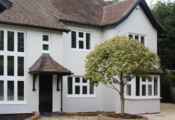 Timber Flush Casement windows with leaded lights and doors for this grand 1920's Cottage in Woking, Surrey