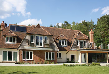 Stylish Flush Casement timber windows and French doors for this individual Arts & Crafts House in Witley, Surrey