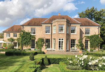 Slimline timber sash windows and French doors for the impressive Newbuild country house in Virginia Water, Surrey