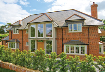 Recessed Edwardian timber casement windows and doors for this unexampled new build Home in Traditional design in Farnham, Surrey