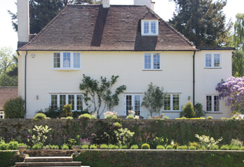 Replacement timber flush casement windows for this 1920's graceful Country house in Esher, Surrey