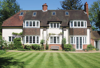 Faithful replacement Flush timber casement windows and French doors for this 1930's traditional cottage in Gerrards Cross, Buckinghamshire