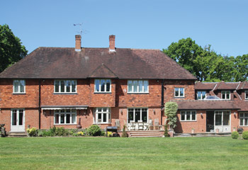 Timber Flush Casement windows and doors for this extended and refurbished country home in Coulsdon, Surrey