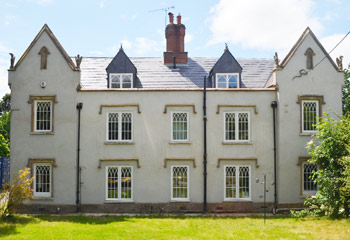 New and replacement Recessed timber casement windows with arched glazing bars for this exceptional country House in Churt, Farnham