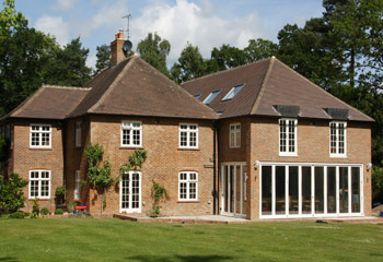 New and replacement Flush timber casement windows and bifold doors for this elegant country house in Reigate, Surrey