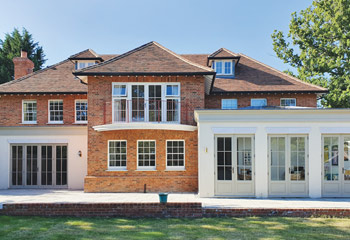 Slimline Flush Casement windows with elegant French doors for this newbuild Arts & Crafts House in Godalming, Surrey