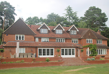 Recessed Casement timber windows, French & Bifold Doors for this grand and elevated Country House in Sunninghill, Berkshire