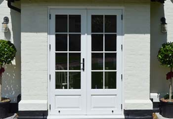 Double French Doors with period panels and glazing bars