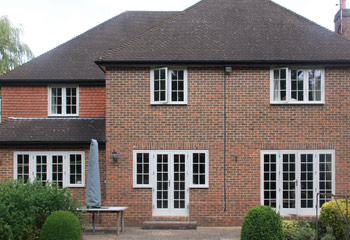 Replacement timber flush casement windows in Light Grey for this cottage in Kew
